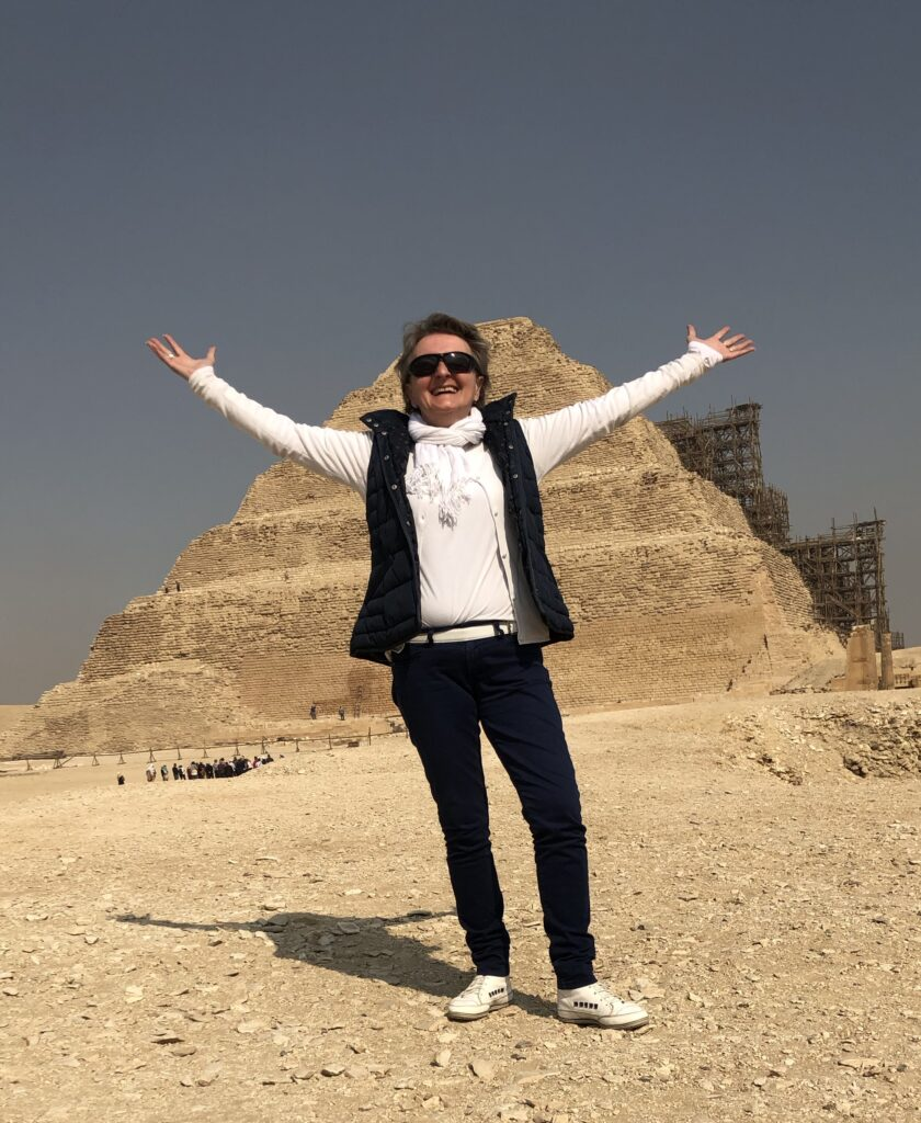 Cristina Teot standing in front of the Step Pyramid at Saqqara